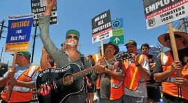 "Tom Morello led demonstrators in songs from his albums Union Town and World Wide Rebel Songs, as well as Pete Seeger's ""This Land Is Your Land"" on July 9."
