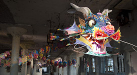 "With Wind, a traditional Chinese paper dragon, serves as a symbol of power. However, its colors represent not the power of authority, but rather of personal freedom. ""Everybody has this power,"" says Ai Weiwei in his memos accompanying the work. ("
