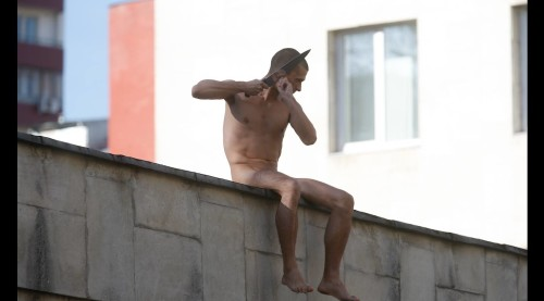Pyotr Pavlensky on the wall of the Serbsky psychiatry centre after he sliced off part of his earlobe in a protest he called 'Segregation'