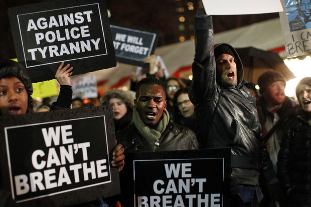 New York Protestors Rally against the decision not to indict the NYPD officer responsible for the death of Eric Garner (Jason DeCrow, Associated Press.)
