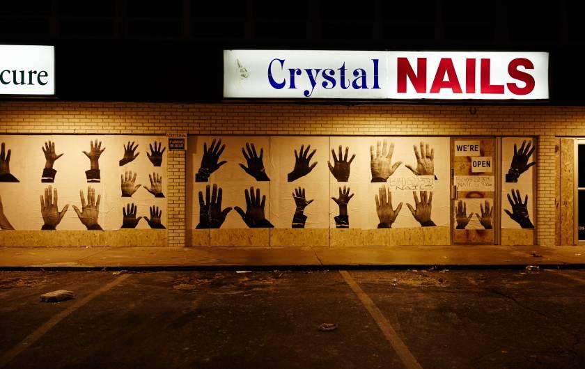 A Ferguson mall, open for business, and an artistic canvas (Sebastiano Tomada.)