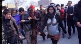 Khademi's performance drew verbal and physical harassment from the predominantly male crowd (Massoud Hossaini, AP.)