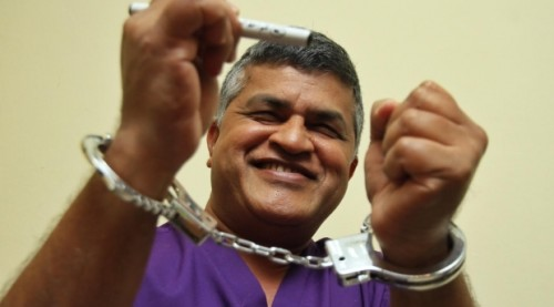 A defiant Zunar following his sentencing to 43 years in prison wears the symbol of his imprisonment with pride (Saw Siow Feng.)