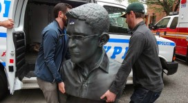 A pair of activist volunteers bring the 100-pound bust of Edward Snowden back to its creators from NYPD custody (Geoffrey Croft/NYC Park Advocates.)