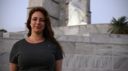 "Tania Bruguera is pictured in Havana's Revolution Square, where her performance ""Yo Tambien Exijo"" (I Also Demand) was cut off by Cuban authorities.  The artwork consisted of an open microphone, and an invitation for Cubans to speak their minds.  On Friday the artist was allowed to flee Cuba, and she is currently in New York (NPR.)"