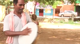 Kovan is pictured criticizing Tamil Nadu's governor in the video which led to his arrest.  The artist has been charged with sedition, criminal intimidation, and dividing social groups for his lyrics.