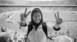 "A woman defiantly gives the peace sign in the music video for ""Shere Rahai,"" or ""Song of Freedom."" The film, published online, has numerous women demonstrating their support of the lyrical message, ""We are happy, joyful and full of laughter Even though we are imprisoned"" (YouTube.)"