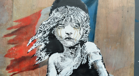 Tears flow from the eyes of Les Miserable's Cosette, assaulted by tear gas, in Banksy's latest work after police raids on Calais' refugee camp (Banksy.)