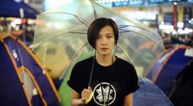 Denise Ho wears the emblem of Hong Kong Shield while carrying the yellow umbrella symbolic of the city's struggle for democracy (South China Morning Post.)